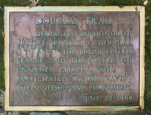 Plaque at the base of the Douglas Trail